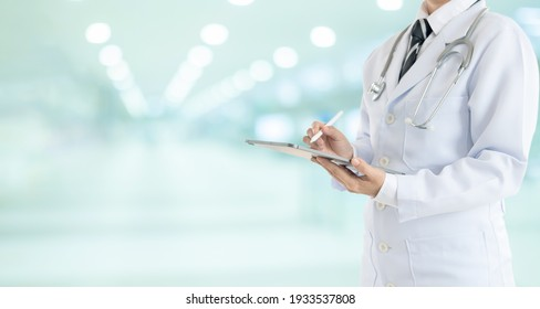 Doctor using digital tablet find information patient medical history at the hospital. Medical technology concept.