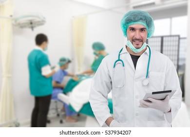 Doctor using digital tablet in operating room - Shutterstock ID 537934207