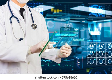 doctor using hi-tech transparency tablet  in operating room