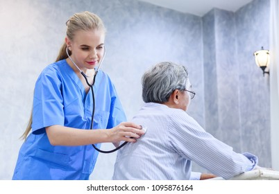 Doctor is using a stethoscope to check back to heart of senior patient