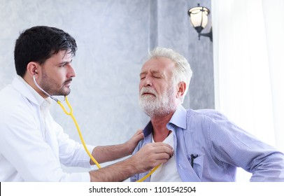 doctor is using a stethoscope to check heart of senior patient