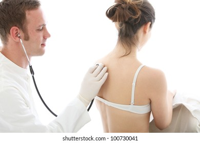Doctor using a stethoscope to listen to a patient breathing isolated on white