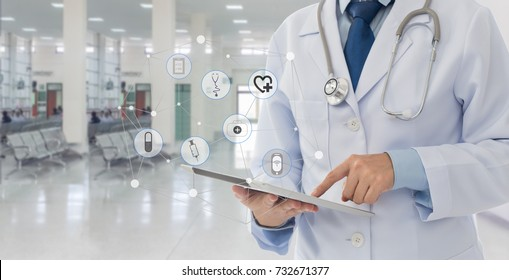 Doctor using a tablet computer in hospital. Concept of medical and health care network.