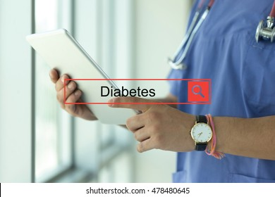 DOCTOR USING TABLET PC SEARCHING DIABETES