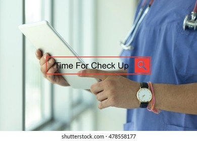 DOCTOR USING TABLET PC SEARCHING TIME FOR CHECK UP