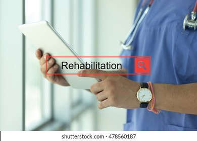 DOCTOR USING TABLET PC SEARCHING REHABILITATION