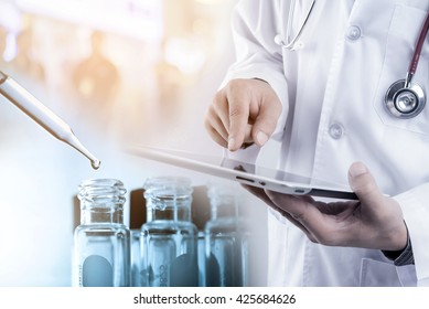 Doctor using tablet with teat tube in rack, medical concept