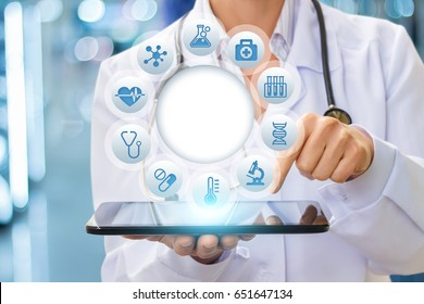 Doctor using tablet testing on blurred background.