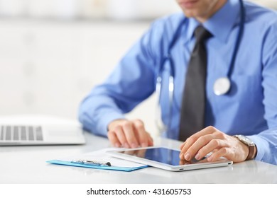 Doctor using tablet for work in hospital