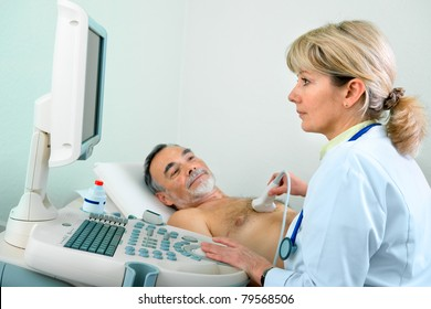 Doctor is using ultrasound machine to scan of a senior male patient