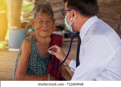 The doctor volunteered to check for old woman's health.thailan asia