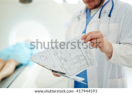 Doctor watching medical record of a patient