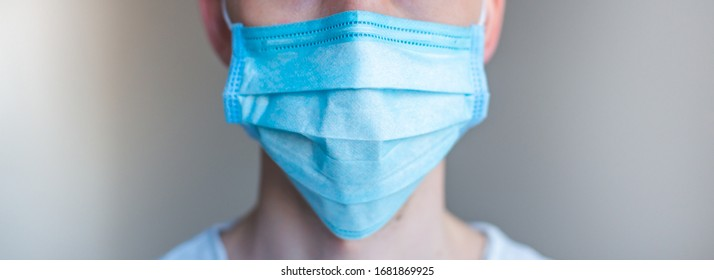 Doctor wearing a protective mask against coronavirus. men wear a mask against the virus. COVID-19. Banner panorama, medical staff, preventive equipment. hospital, laboratory, clinic.