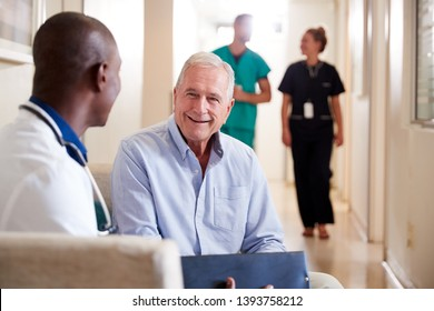 Doctor Welcoming To Senior Male Patient Being Admitted To Hospital