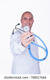 Doctor with white coat offering his stethoscope on white background
