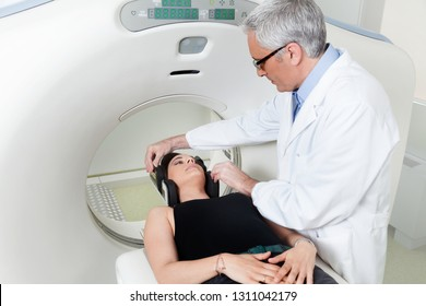 doctor in white coat is preparing patient for magnetic resonance imaging machine MRI computed tomography at hospital.