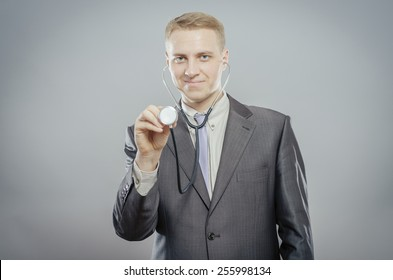 The doctor in a white lab coat holding a stethoscope