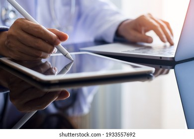 Doctor in white lap coat, hand using stylus pen or electronic pencil on digital tablet at workplace. Online medical learning concept.
