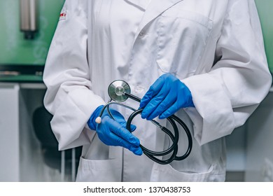 doctor in a white robe holding a phonendoscope