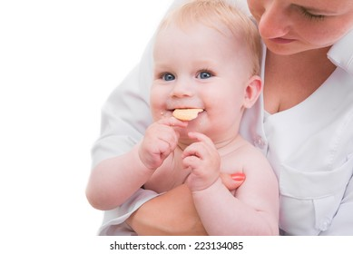 Doctor woman holding a baby in her arms