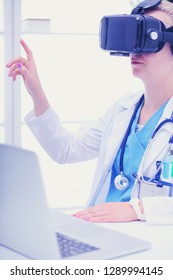 Doctor woman looking through phoropter during eye exam. Doctor woman