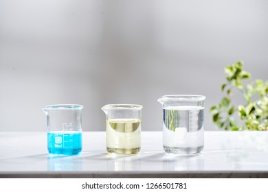 doctor woman scientist making herbal medicine in lab with herb leaves vitamin supplements mineral alternative treatment research.