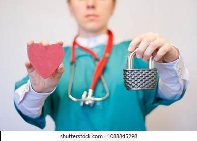 Doctor woman with stethoscope offers padlock and red heart. Security Healthcare Data.