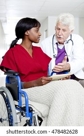 A doctor with a woman in a wheelchair