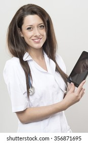 doctor work with black tablet. isolated on gray background.