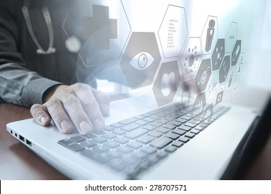 Doctor working with digital tablet and laptop computer in medical workspace office and overcast exposure effect