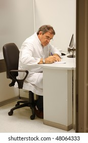 Doctor working in his office