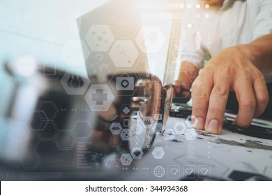 doctor working with laptop computer in medical workspace office and digital health care network media diagram layer with stethoscope and eyeglass foreground as concept