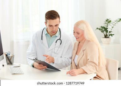 Doctor working with mature patient in hospital