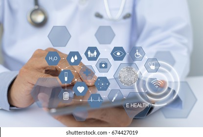 Doctor working on digital tablet computer with health icons flow, telemedicine, electronics health record system EHRs, electronics medical record system EMRs, internet health application conceptual