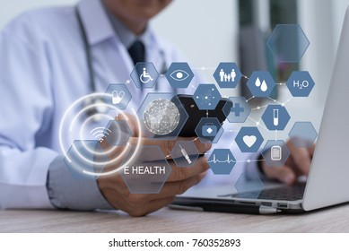 Doctor working on laptop computer and smartphone with health icons, telemedicine electronics health record system EHRs, electronics medical record system EMRs, e health application concept