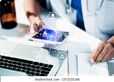 Doctor working on laptop and hologram  modern virtual screen interface.