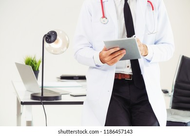 Doctor working on tablet computer at office in the hospital. Medical and healthcare concept.