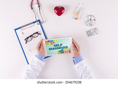 Doctor workplace with SELF DIAGNOSIS on tablet