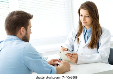 Doctor writes out the pills to the patient