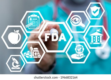Doctor writing marker a FDA abbreviation on virtual touch screen. Concept of FDA Approved. Food and Drug Administration.