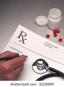 Doctor writing out RX prescription on stainless steel desk