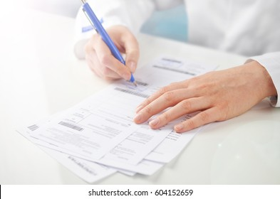 Doctor writing a prescription.