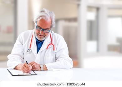 Doctor writing prescription and updating medical report