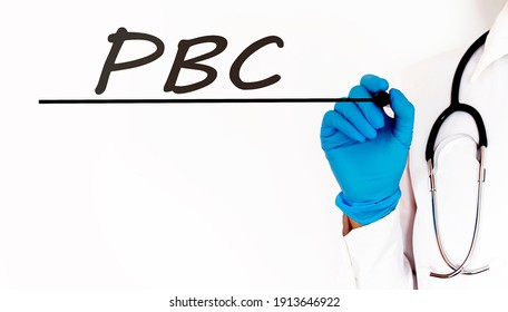 Doctor writing text PBC Medical concept on white background