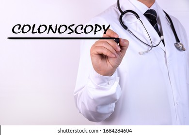 Doctor writing word Colonoscopy with marker Medical concept