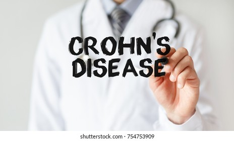 Doctor writing word Crohn's disease with marker, Medical concept