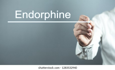 Doctor writng Endorphine text in screen.