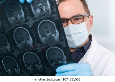 Doctor with an x-ray image of a human brain