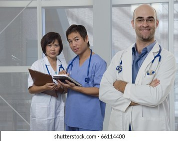 Doctor,Nurse and Intern standing with white background