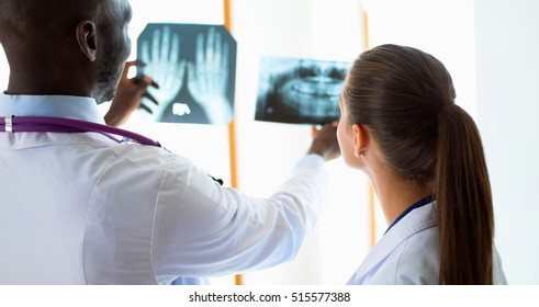 Doctors analyzing an x-ray in a meting